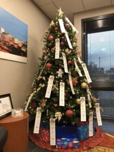 A decorated Christmas Tree with 40 angle tree donation tags hanging on it.
